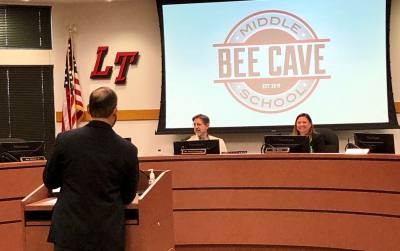 Lake Travis ISD Director of Communications Marco Alvarado presents the new Bee Cave Middle School logo to the board of trustees May 15.