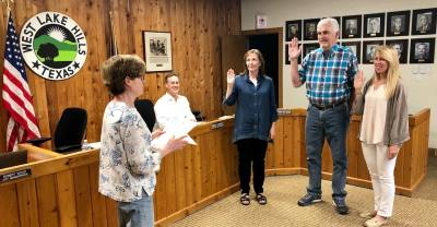 Standing from left, Mayor Linda Anthony administers the oaths of office to Beth South, Jim O'Connor and Rhonda McCollough  at the May 22 West Lake Hills City Council meeting.