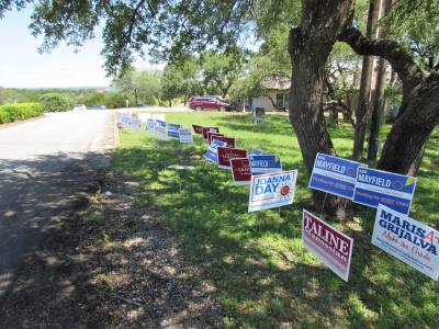 Candidate signs line the road leading to Dripping Springs' polling location May 4.