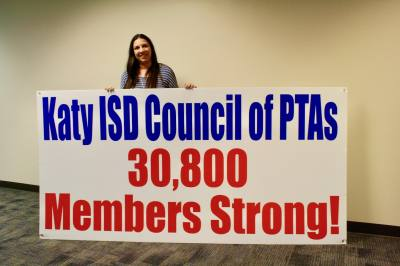 Katy ISD Council of PTAs President Georgia Strickland stands with a sign she made about two weeks ago. As of May 20, membership has grown to 31,681, she said.