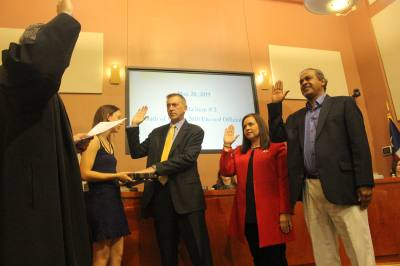 Lakeway Mayor Sandy Cox, along with new council members Sanjeev Kumar, Doug Howell, and Gretchen Vance, were sworn into office May 20 to a packed City Hall.