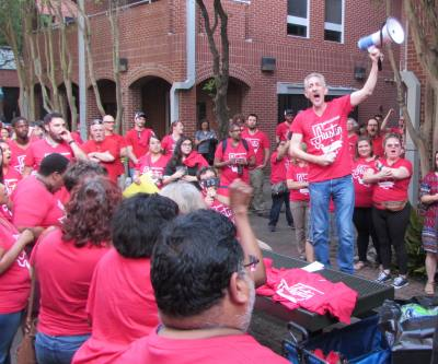 Education Austin President Ken Zarifis led a crowd of local Austin ISD employees at a rally May 20.