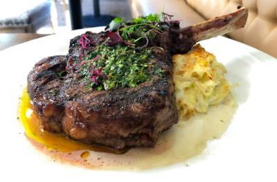 Visconti Ristorante & Bar's Bone-in nNiman Ranch nRibeye includes Alla Diavola butter, potato gratin and green onion.