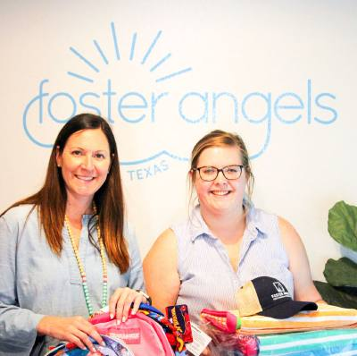 Tania Leskovar-Owens (left) and Maggie Sheppard pose with some of the items they will give to foster children in Central Texas.