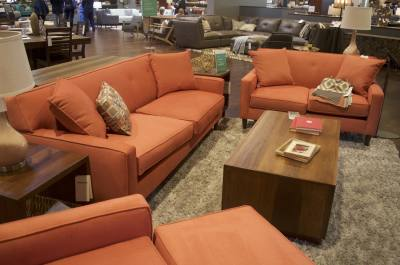 A living room furniture set is displayed during Living Spaces grand opening in Pflugerville.