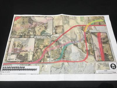 McKinney Mayor George Fuller presented three alignment options to residents at a town hall meeting May 14. The pink, yellow and teal lines are intended to start discussions.