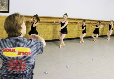 Stacy Gayan, one of the instructors at Gotta Dance, walks her students through a series of dance exercises.