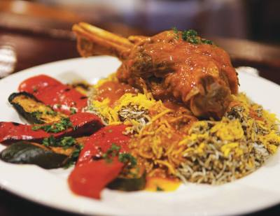 The braised lamb shank ($16.95) comes on a bed of dill rice and with seasoned vegetables.