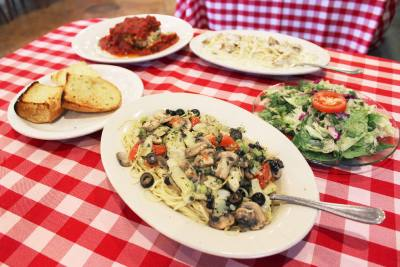 All pasta dishes, like the restaurantu2019s lasagna ($9.99), Puttanesca ($11.99) and Fettuccine Alfredo with chicken ($13.99), are served with garlic bread and a house salad.