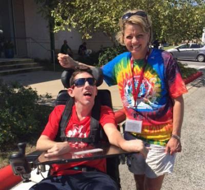 Barbara Thomason smiles with James Parker, owner of Shredding on the Go, at CreekFest Houston.