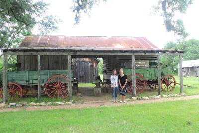 Director of Marketing and Events Jenny Pack (left) and Director of Museum Operations Liz Lubrani stand in front of the Poundsu2019 barn and wagon.