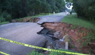 This photo was taken from an ABC 13 video of the moment Hamblen Road collapsed.