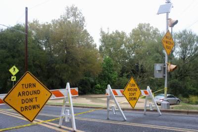 Multiple low-water crossings on Spicewood Springs Road have been closed.