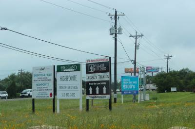 Along Hwy. 290 in South Austin, signs of new and developing housing communities are plentiful.