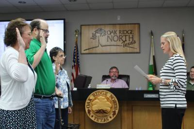 From left, Oak Ridge North City Council Members Dawn Candy, Clint McClaren and Frances Planchard are sworn in by City Secretary Elizabeth Harrell.