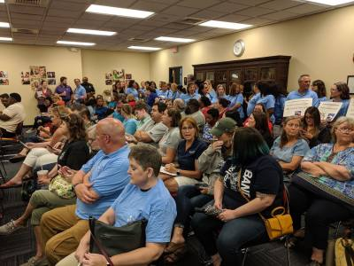 Members of the Pflugerville Educators Association pack the district's board room June 25 to advocate for higher compensation increases.