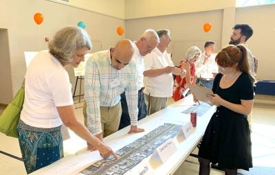 At a July 9 open house, city of Austin staffers go over updated design plans for Burnet Road improvements, which include adding a median to restrict left turns.