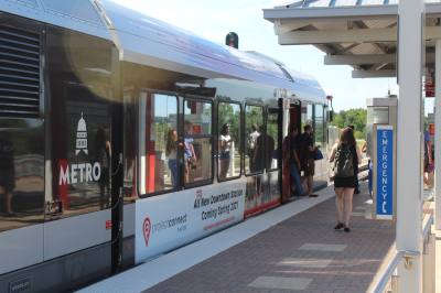 People exit the MetroRail at Leander Station on July 17.
