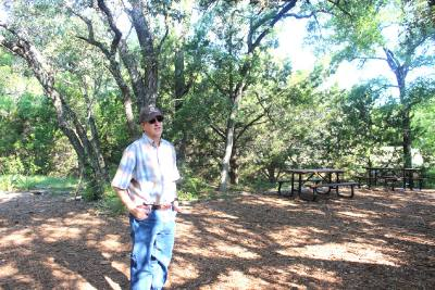 Bob Ayres, a Shield Ranch co-owner and president and CEO of the Shield Ranch Foundation, stands at the area used as the El Ranchito campground.