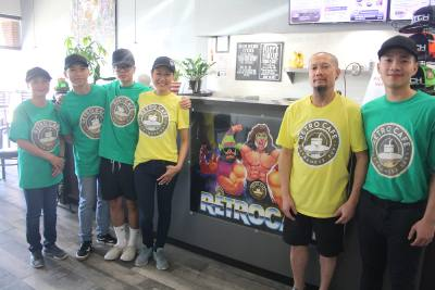 Phoenix Pham (center, right) and Tonee Nguyen (second from right) opened Retro Cafe in Cypress in 2018.