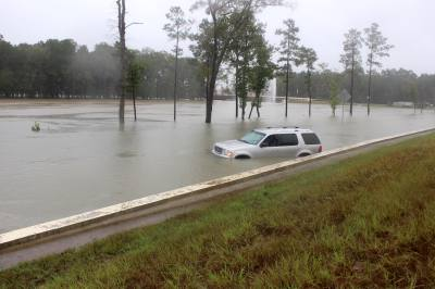 High water covered parts of Grand Parkway feeder lanes near Valley Ranch Parkway on Sept. 19.