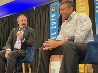 Local entrepreneur JT McCormick (right) speaks with Community Impact Newspaper CEO John Garrett on Oct. 24 during the company's 2019 Thrive conference in Pflugerville, Texas.